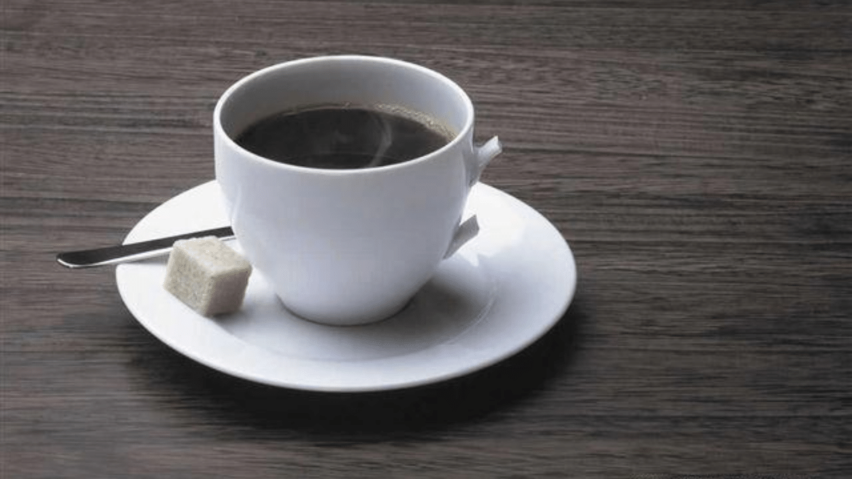 Van Gogh Museum Cafe - coffee cup with coffee on dark wood table