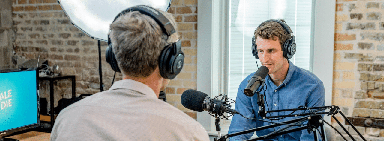 radio presenters talking on air with headphones and microphones