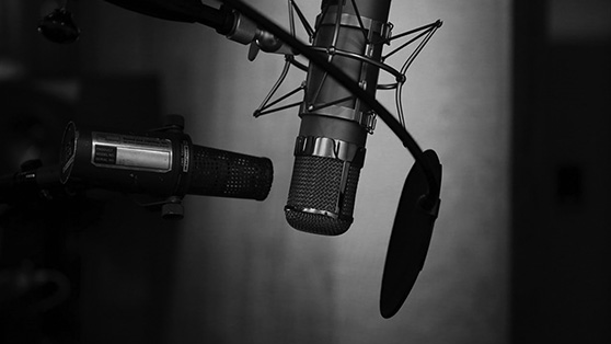 microphones in recording studio for radio artists | Empire ultimate guide to radio advertising